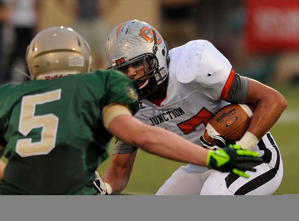 . HIGHLANDS RANCH, CO. - AUGUST 31:  Grand Junction running back Theron Verna (47) ran into Mountain Vista defender Tyson Fisher (5) in the first quarter. The Mountain Vista High School football team hosted Grand Junction at Shea Stadium Saturday night, August 31, 2013. Photo By Karl Gehring/The Denver Post
