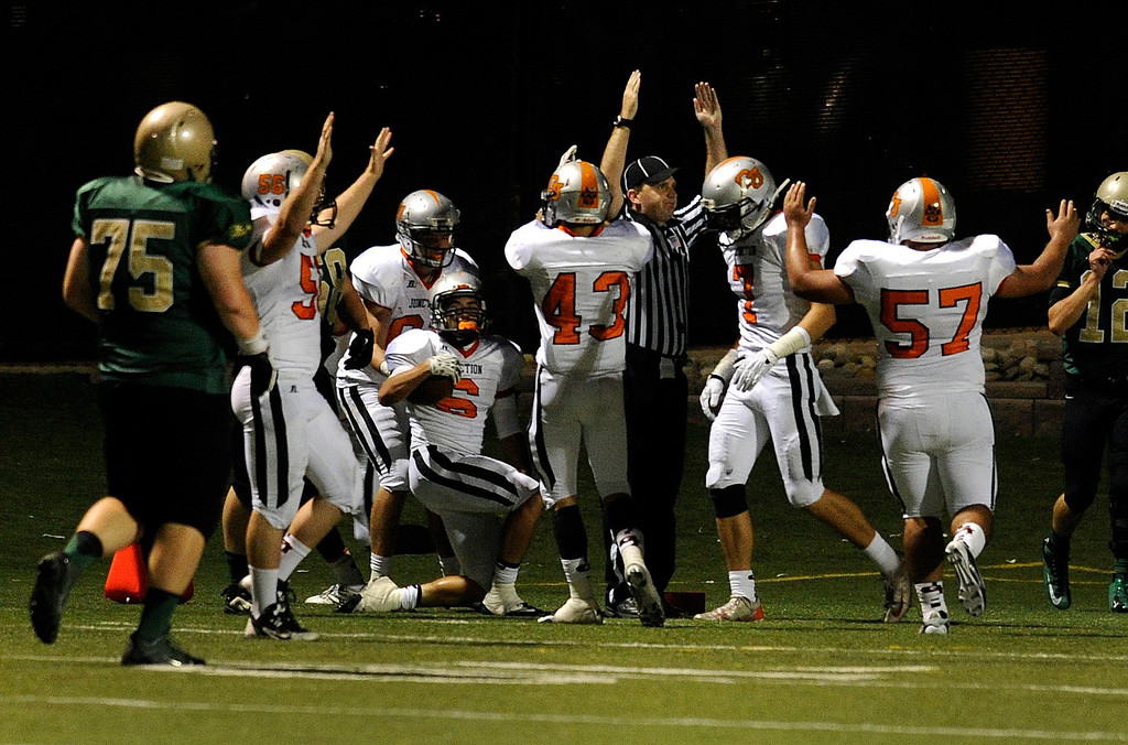 . HIGHLANDS RANCH, CO. - AUGUST 31:  Tigers\' defensive back Dion Martinez (6) returned an interception for a touchdown in the fourth quarter. Mountain Vista senior running back Tanner Smith (34) rushed for a touchdown in the fourth quarter. The Grand Junction Tigers defeated Mountain Vista 49-13 at Shea Stadium Saturday night, August 31, 2013. Photo By Karl Gehring/The Denver Post