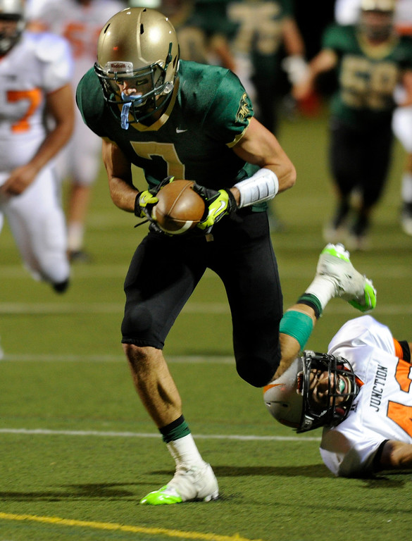 . HIGHLANDS RANCH, CO. - AUGUST 31:  Mountain Vista receiver Rocco Palumbo (7) broke free for a touchdown in the third quarter. The Grand Junction Tigers defeated Mountain Vista 49-13 at Shea Stadium Saturday night, August 31, 2013. Photo By Karl Gehring/The Denver Post