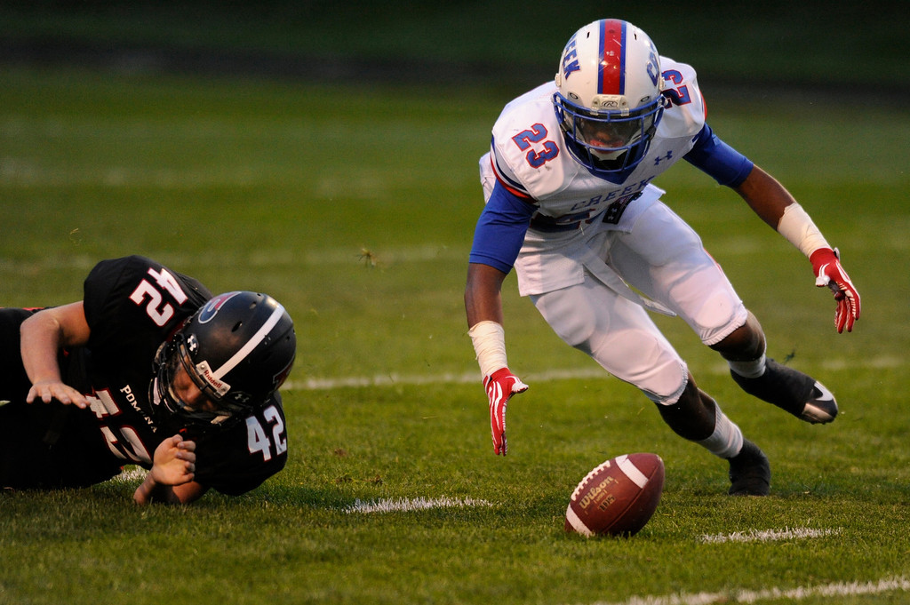 . ARVADA, CO. - SEPTEMBER 6: Bruins returner Kory Taylor (23) recovered his own fumble on a punt in the first quarter. The Pomona High School football team hosted Cherry Creek Friday night, September 6, 2013. Photo By Karl Gehring/The Denver Post