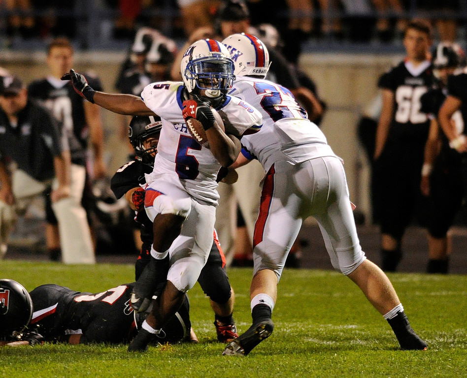 . ARVADA, CO. - SEPTEMBER 6: Bruins\' running back Milo Hall (5) broke out of a tackle and went all the way for a touchdown in the third quarter. The Cherry Creek High School football team defeated Pomona 19-15 Friday night, September 6, 2013. Photo By Karl Gehring/The Denver Post