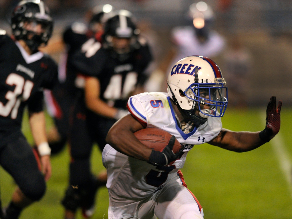. ARVADA, CO. - SEPTEMBER 6: Creek running back Milo Hall found room to run in the second half. The Cherry Creek High School football team defeated Pomona 19-15 Friday night, September 6, 2013. Photo By Karl Gehring/The Denver Post