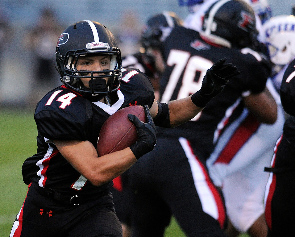 . ARVADA, CO. - SEPTEMBER 6: Pomona senior running back Chris Marquez (14) found room to run in the first quarter. The Pomona High School football team hosted Cherry Creek Friday night, September 6, 2013. Photo By Karl Gehring/The Denver Post