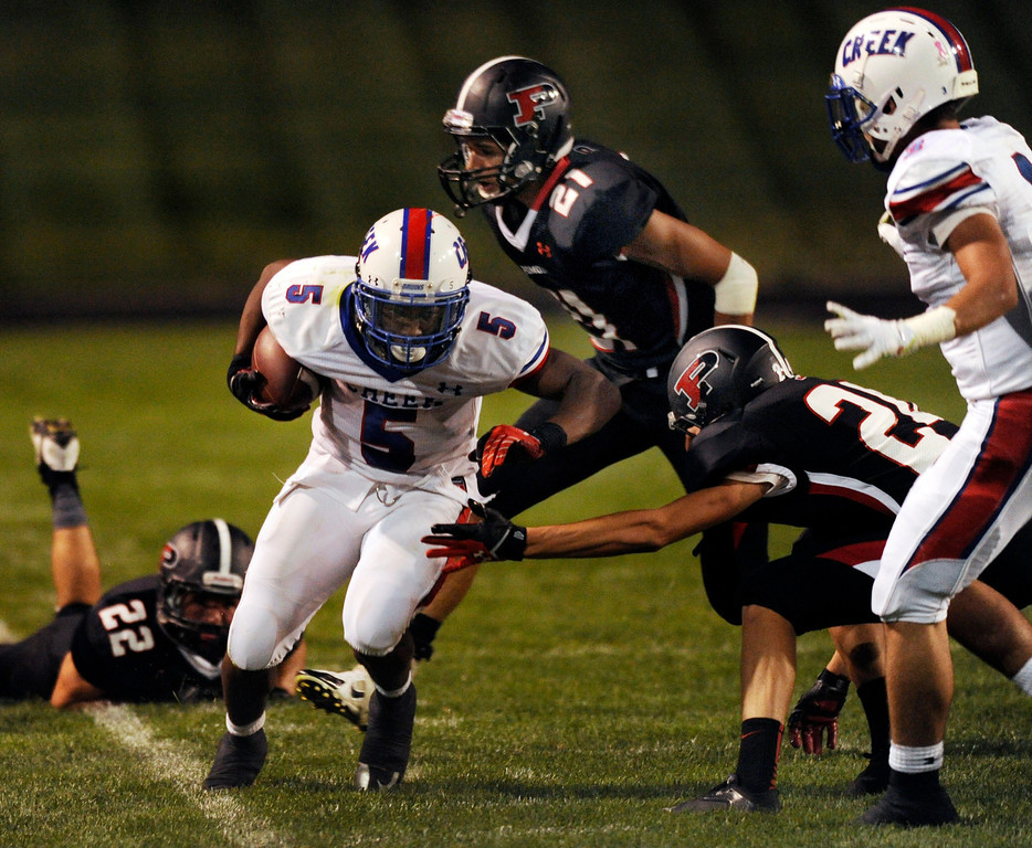 . ARVADA, CO. - SEPTEMBER 6: Bruins\' junior running back Milo Hall (5) was forced out of bounds on a second quarter pickup. The Pomona High School football team hosted Cherry Creek Friday night, September 6, 2013. Photo By Karl Gehring/The Denver Post