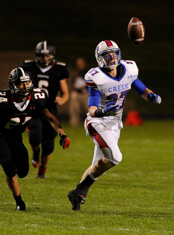 . ARVADA, CO. - SEPTEMBER 6: Bruins\' receiver Mike McCauley bobbled a pass in the third quarter. The Cherry Creek High School football team defeated Pomona 19-15 Friday night, September 6, 2013. Photo By Karl Gehring/The Denver Post
