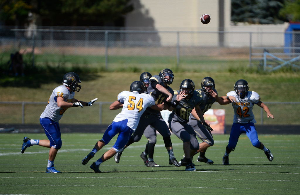 . LAFAYETTE, CO - SEPTEMBER 07: Monarch High QB, Jay MacIntyre, center, throws and completes a pass to Sam Lehman, (not pictured) in the second quarter of play at the Howard Spangenberg Field in Lafayette Colorado, Saturday morning, September 07, 2013. (Photo By Andy Cross/The Denver Post)