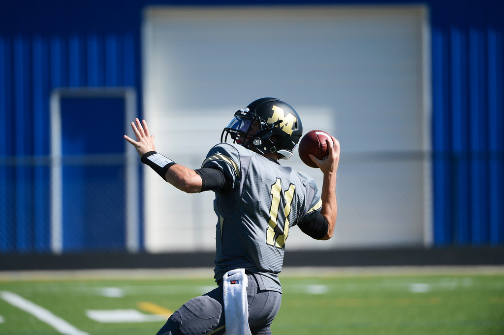 . LAFAYETTE, CO - SEPTEMBER 07: Monarch High QB, Jay MacIntyre throws in the first quarter of play against the Wheat Ridge Farmers at the Howard Spangenberg Field in Lafayette Colorado, Saturday morning, September 07, 2013. (Photo By Andy Cross/The Denver Post)