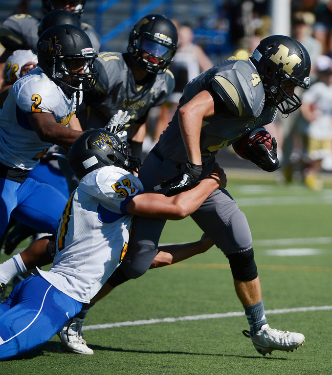 . LAFAYETTE, CO - SEPTEMBER 07: Monarch High RB, Philip Bubernak, right, gets brought down by Wheat Ridge DB, Brendan Moss, in the second quarter of play at the Howard Spangenberg Field in Lafayette Colorado, Saturday morning, September 07, 2013. (Photo By Andy Cross/The Denver Post)