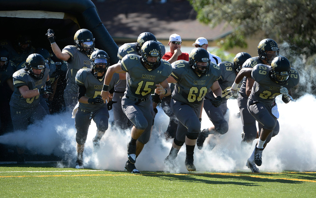. LAFAYETTE, CO - SEPTEMBER 07: The Monarch High School football team takes the field to play Wheat Ridge at the Howard Spangenberg Field in Lafayette Colorado, Saturday morning, September 07, 2013. (Photo By Andy Cross/The Denver Post)