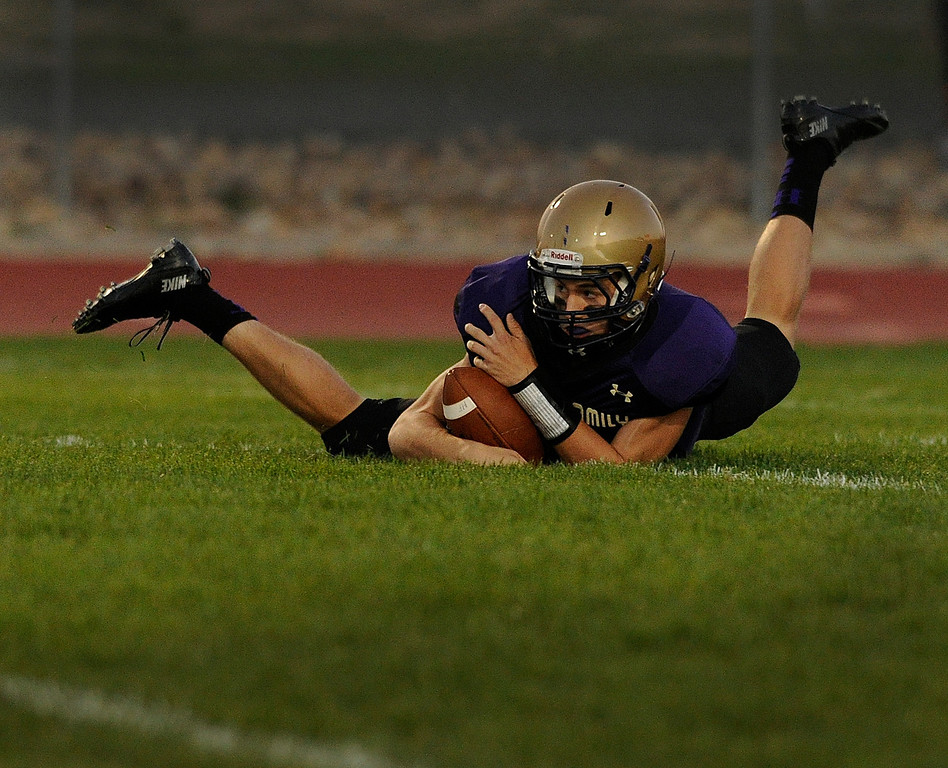 . BROOMFIELD, CO. - SEPTEMBER 20: Holy Family quarterback David Sommers (7) fell on a loose ball following a bad snap in the first half. The Holy Family High School football team hosted Silver Creek Friday night September 20, 2013.  Photo By Karl Gehring/The Denver Post