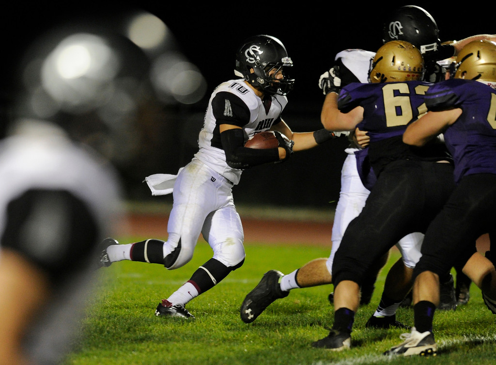 . BROOMFIELD, CO. - SEPTEMBER 20: Silver Creek running back Anthony Kasper (10) followed his blockers in the second half. The Silver Creek High School football team defeated Holy Family 45-14 Friday night September 20, 2013 in Broomfield.  Photo By Karl Gehring/The Denver Post