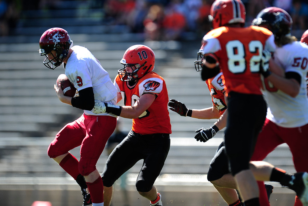 . Anders Hill tries to break free from Danny Collins.  (Photo By Erin Hull/The Denver Post)