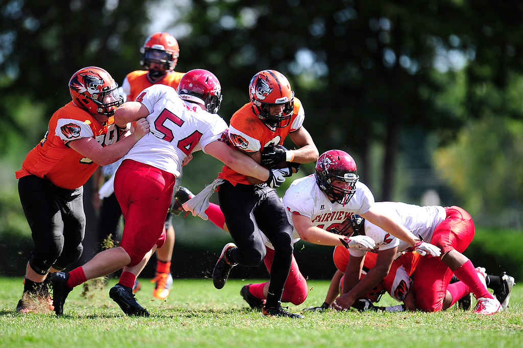 . Junior Toby Galvan fights through the Fairview Knights.  (Photo By Erin Hull/The Denver Post)