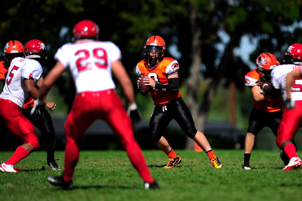 . Quarterback Casey Nicholls looks for an opening during the 3rd quarter of play.  (Photo By Erin Hull/The Denver Post)