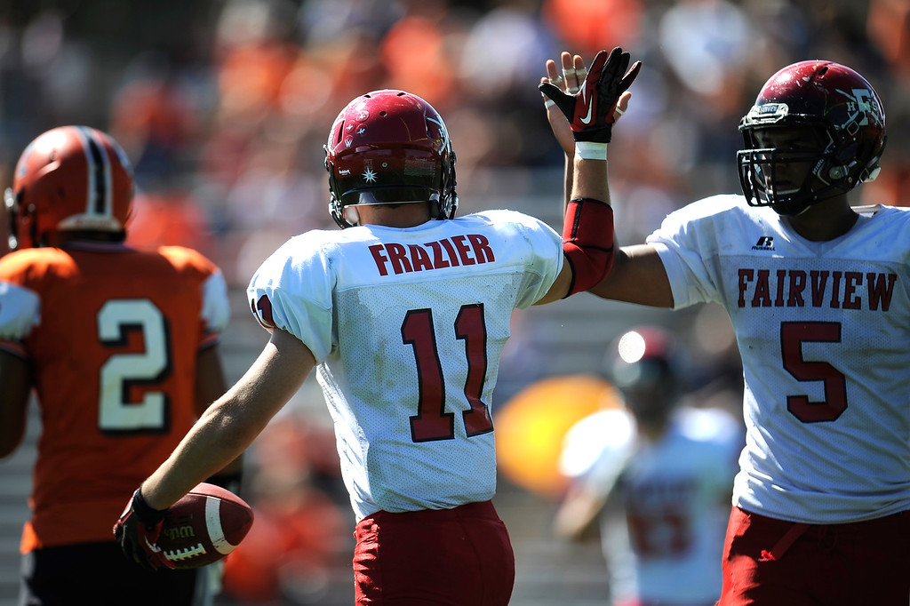 . Cameron Frazier and Carlo Kemp high five each other after a play against Lakewood.  (Photo By Erin Hull/The Denver Post)