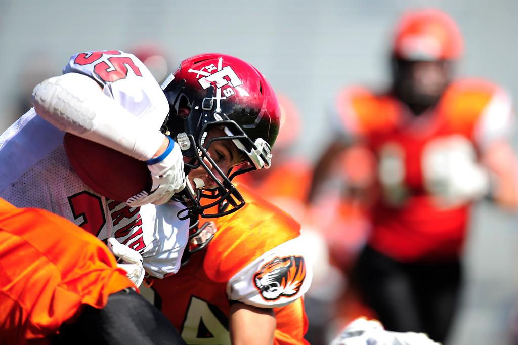 . Owen Harris breaks through Lakewood defense. (Photo By Erin Hull/The Denver Post)