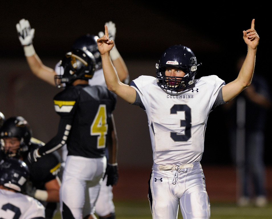 . Columbine quarterback Michael Tait (3) helped the officials make the touchdown call in the second quarter. The Arapahoe High School football team hosted Columbine at the Littleton Public Schools District Stadium Thursday night, September 26, 2013. Photo By Karl Gehring/The Denver Post