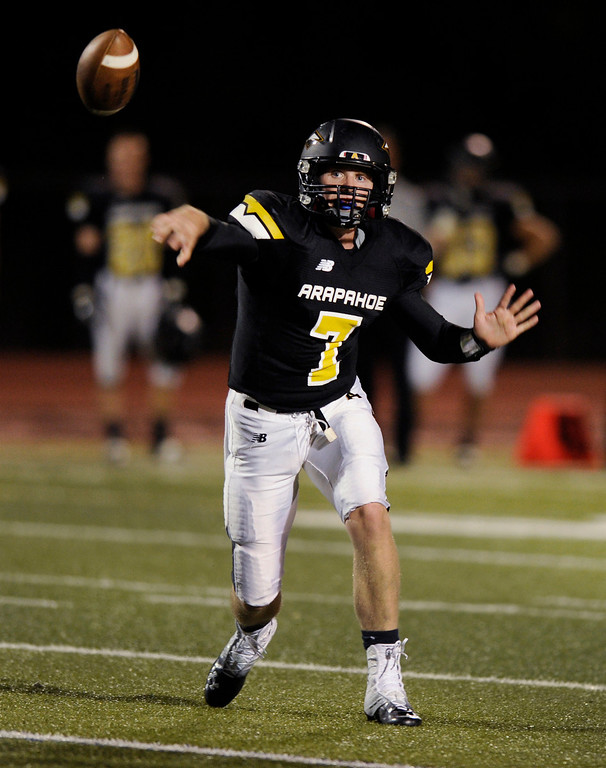 . Arapahoe quarterback Gabe Peterson (7) released a pass in the first half. The Arapahoe High School football team hosted Columbine at the Littleton Public Schools District Stadium Thursday night, September 26, 2013. Photo By Karl Gehring/The Denver Post