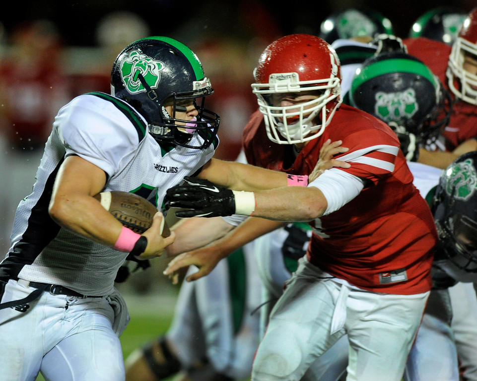 . AURORA, CO. - SEPTEMBER 27: Grizzlies\' back Steve Ray tried to get to the edge on fourth quarter run Friday night. The Regis Jesuit High School football team steamrolled  ThunderRidge 35-12 Friday night, September 27, 2013. Photo By Karl Gehring/The Denver Post