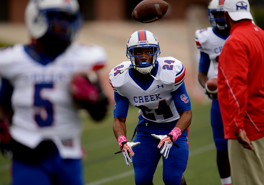 . RB Nathan Starks of Cherry Creek High School (24) is warming up for the game against Smoky Hill High School at Stutler Bowl. Greenwood Village, Colorado. October 11, 2013. (Photo by Hyoung Chang/The Denver Post)