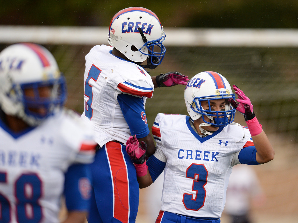 . Milo Hall (5) celebrates the punt return touchdown of Joseph Parker of Cherry Creek High School (3) in the 1st quarter of the game against Smoky Hill High School at Stutler Bowl. Greenwood Village, Colorado. October 11, 2013. (Photo by Hyoung Chang/The Denver Post)
