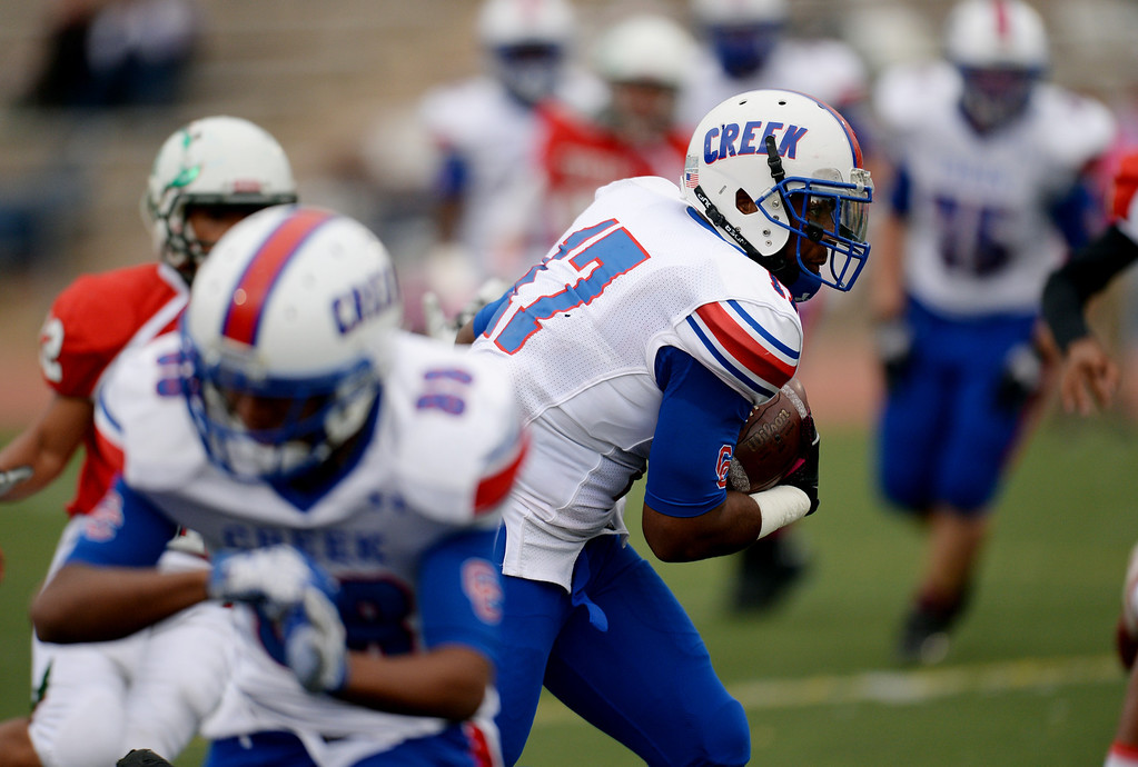 . Patrick O\'Malley of Cherry Creek High School controls the ball against Smoky Hill High School defense in the 2nd quarter of the game at Stutler Bowl. Greenwood Village, Colorado. October 11, 2013. Cherry Creek won 48-14. (Photo by Hyoung Chang/The Denver Post)