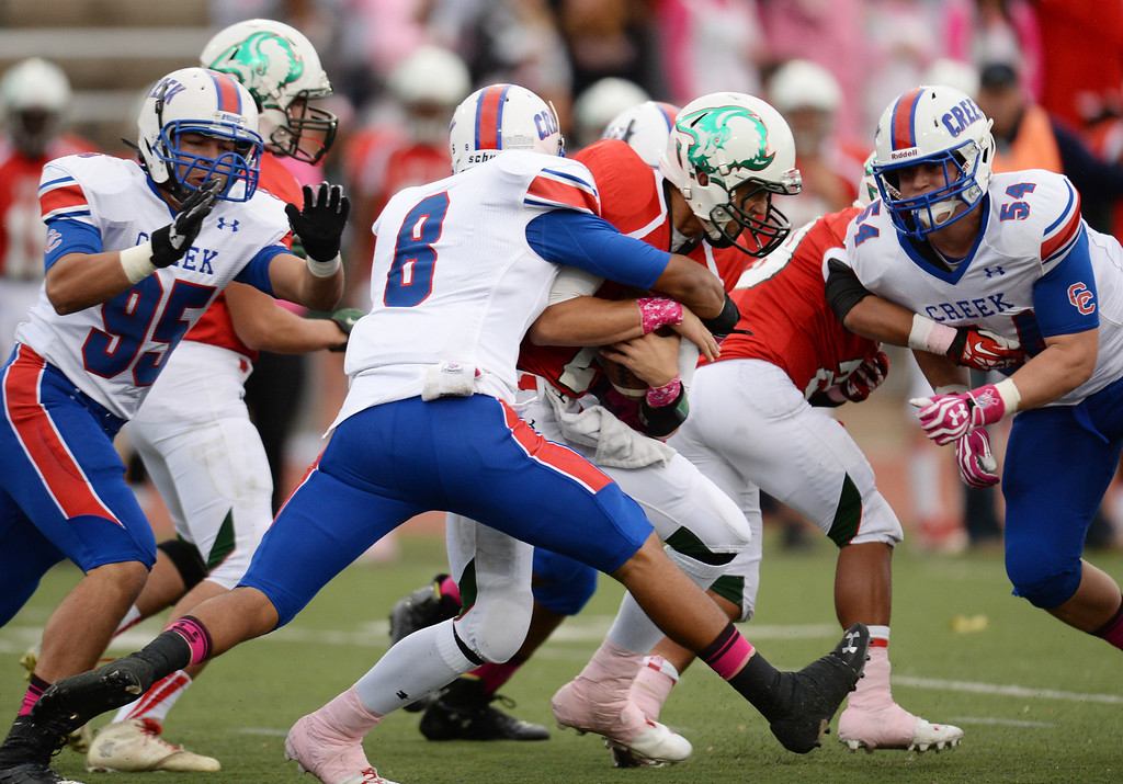 . LB Jaylon Jones of Cherry Creek High School (8) sacks QB Trent Clay of Smoky Hill High School in the 1st quarter of the game at Stutler Bowl. Greenwood Village, Colorado. October 11, 2013. (Photo by Hyoung Chang/The Denver Post)