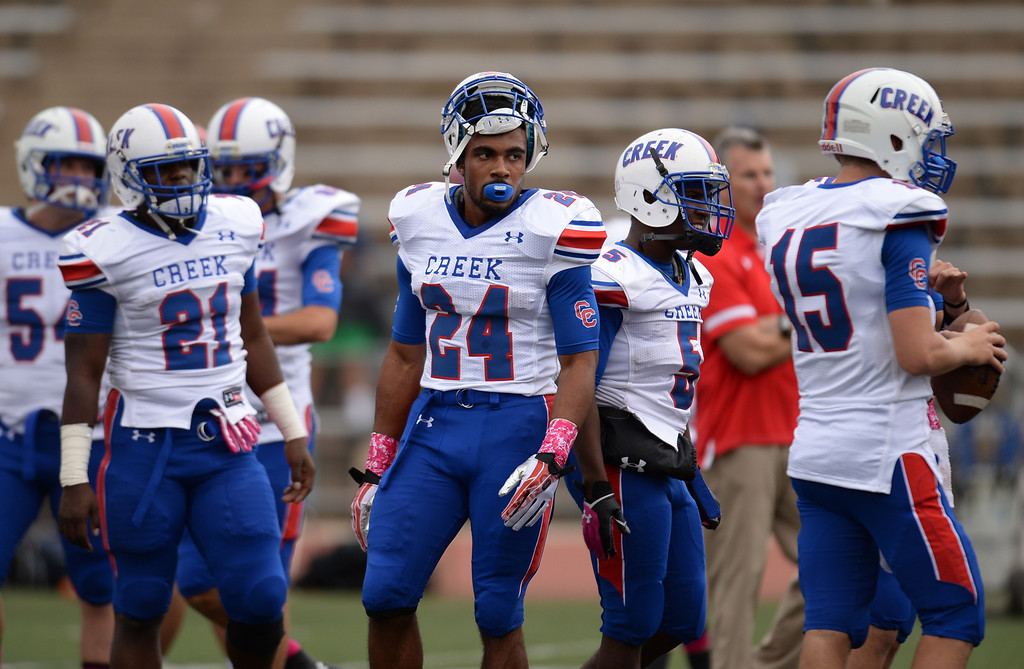 . RB Nathan Starks of Cherry Creek High School (24) is warming up with the teammates for the game against Smoky Hill High School at Stutler Bowl. Greenwood Village, Colorado. October 11, 2013. (Photo by Hyoung Chang/The Denver Post)