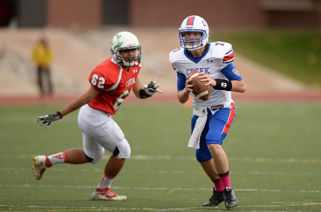 . QB Cameron Brucker of Cherry Creek High School (7) controls the ball against Smoky Hill High School defense in the 1st quarter of the game at Stutler Bowl. Greenwood Village, Colorado. October 11, 2013. (Photo by Hyoung Chang/The Denver Post)
