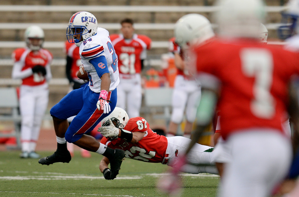 . RB Nathan Starks of Cherry Creek High School (24) controls the ball against Smoky Hill High School defense in the 1st quarter of the game at Stutler Bowl. Greenwood Village, Colorado. October 11, 2013. (Photo by Hyoung Chang/The Denver Post)