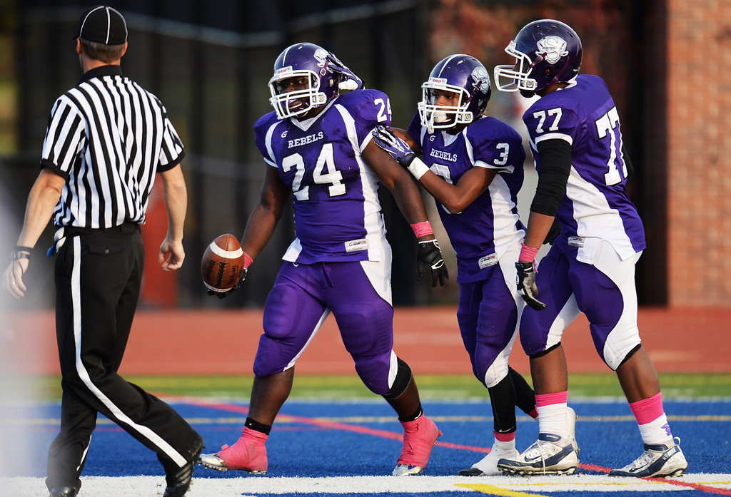 . DENVER, CO - OCTOBER 25 : From left, Travante Tasco (24), Malcolm Wright (3) and Dakarai Box (77)  of South High School celebrate Tasco\'s touchdown in the 1st half of the game against Green Mountain High School at All-City Stadium. Denver. Colorado. October 25, 2013. South High School won 47-0. (Photo by Hyoung Chang/The Denver Post)