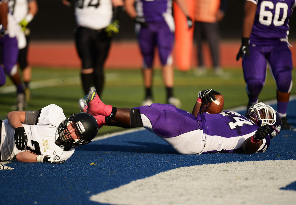 . DENVER, CO - OCTOBER 25 : Travante Tasco of South High School (24) dives for a touchdown in the 1st half of the game against Green Mountain High School at All-City Stadium. Denver. Colorado. October 25, 2013. South High School won 47-0. (Photo by Hyoung Chang/The Denver Post)