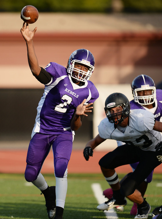 . DENVER, CO - OCTOBER 25 : Tyson Purifoy of South High School (2) throws a pass in the 1st half of the game against Green Mountain High School at All-City Stadium. Denver. Colorado. October 25, 2013. South High School won 47-0. (Photo by Hyoung Chang/The Denver Post)