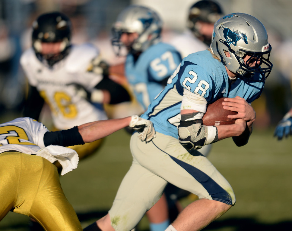 . ARVADA, CO - NOVEMBER 01 : Andrew Wingard of Ralston Valley High School (28) rushes for a touchdown in the 1st half of the game against Arapahoe High School at NAAC Stadium. Arvada, Colorado. November 01, 2013. Ralston Valley won 58-28. (Photo by Hyoung Chang/The Denver Post)