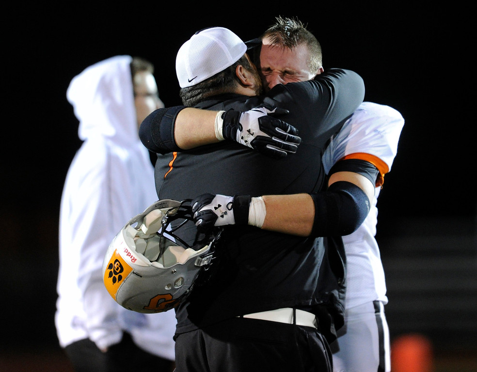 . LAKEWOOD, CO. - NOVEMBER 8: Grand Junction senior lineman Quinton Walton (73) absorbed the emotional end to the season Friday night. The Columbine High School football team rolled over Grand Junction 41-6 in a playoff game at Jefferson County Stadium Friday night, November 8, 2013. Photo By Karl Gehring/The Denver Post