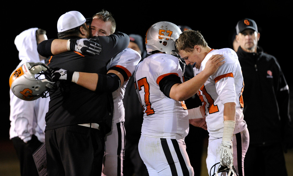 . LAKEWOOD, CO. - NOVEMBER 8: Grand Junction players absorbed the emotional end to the season Friday night. The Columbine High School football team rolled over Grand Junction 41-6 in a playoff game at Jefferson County Stadium Friday night, November 8, 2013. Photo By Karl Gehring/The Denver Post