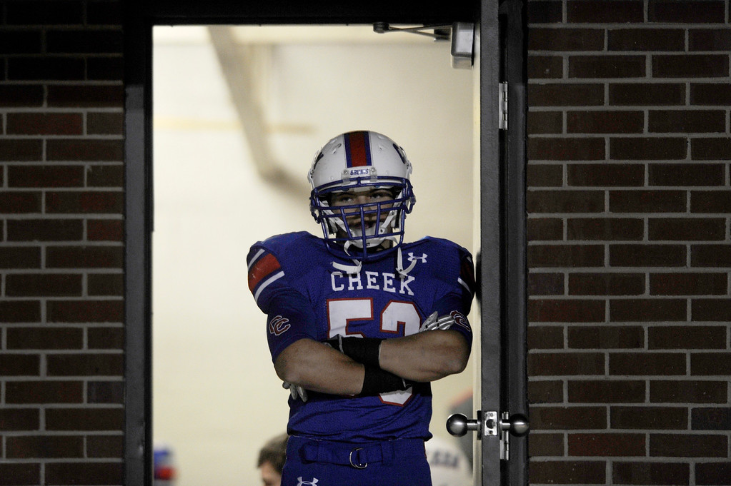 . GREENWOOD VILLAGE CO: Nov. 15, 2013  Cherry Creek\'s Zach Roman stands in the door of the locker room during half time of their game against Cherokee Trail on Nov. 15, 2013 at Stutler Bowl in Greenwood Village, CO.    (Photo By Erin Hull/The Denver Post)
