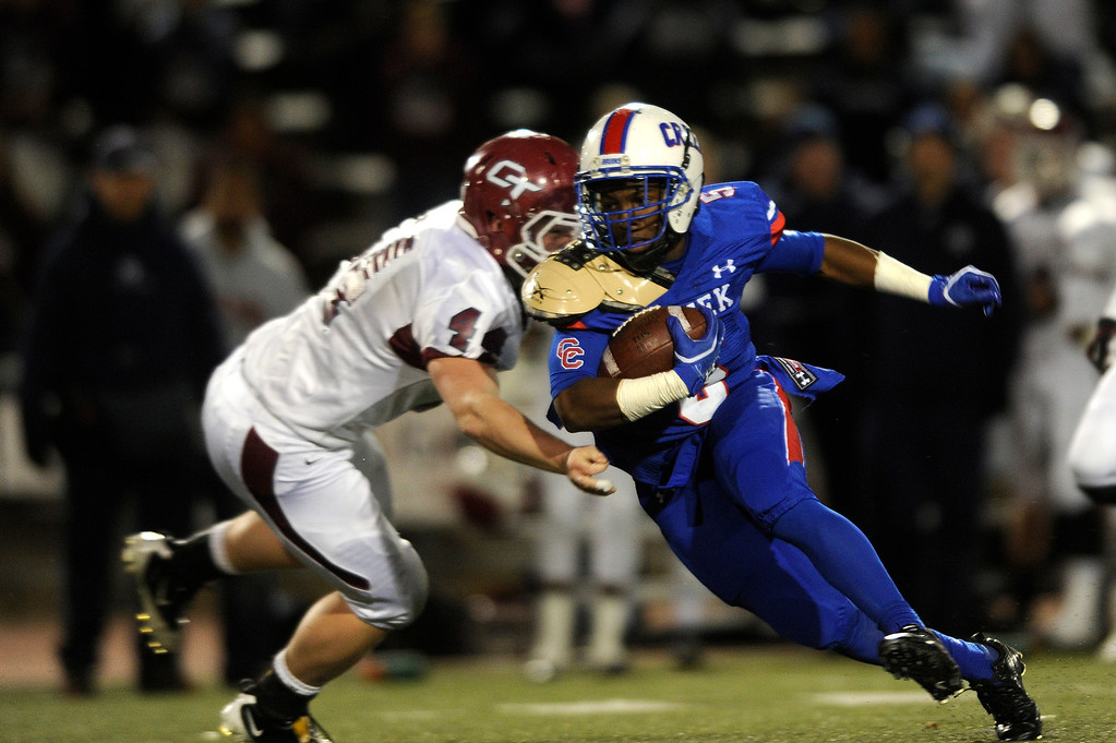 . GREENWOOD VILLAGE CO: Nov. 15, 2013  Cherry Creek player Milo Hall charges past a Cherokee Trail player during the first quarter. Cherry Creek tookon Cherokee Trail on Nov. 15, 2013 at Stutler Bowl in Greenwood Village, CO.    (Photo By Erin Hull/The Denver Post)