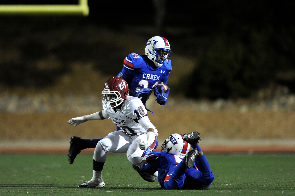 . GREENWOOD VILLAGE CO: Nov. 15, 2013  Cherry Creek Nathan Starks carries the ball down field during the first quarter. Cherry Creek took on Cherokee Trail on Nov. 15, 2013 at Stutler Bowl in Greenwood Village, CO.    (Photo By Erin Hull/The Denver Post)