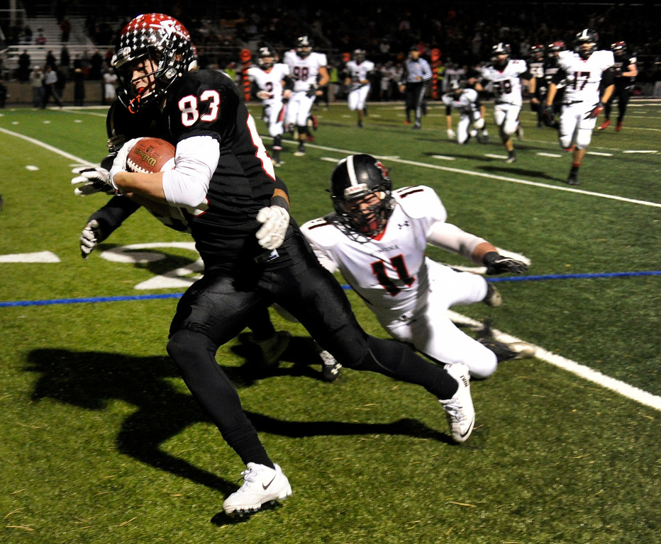 . BOULDER, CO. - NOVEMBER 15: Fairview wide receiver Sam Martin (83) found room to run after a catch in the second half. The Fairview High School football team defeated Pomona 35-24 Friday night, November 15, 2013. Photo By Karl Gehring/The Denver Post