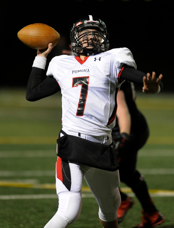 . BOULDER, CO. - NOVEMBER 15: Pomona quarterback Justin Roberts (7) threw a final interception late in the fourth quarter. The Fairview High School football team defeated Pomona 35-24 Friday night, November 15, 2013. Photo By Karl Gehring/The Denver Post