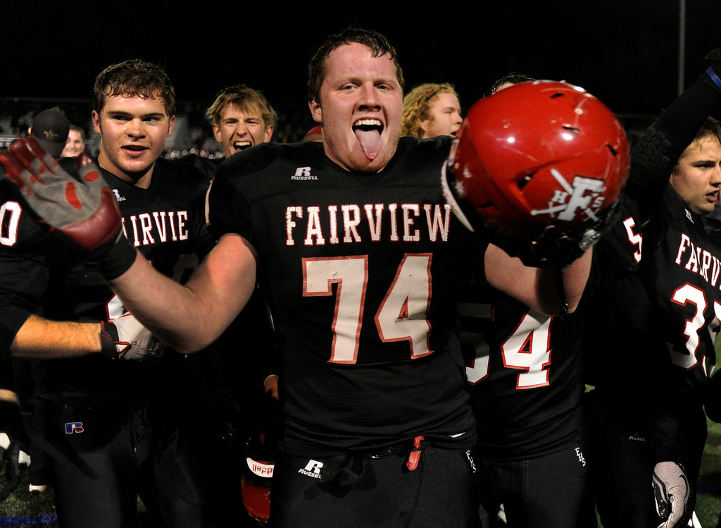 . BOULDER, CO. - NOVEMBER 15: Knights lineman Conner Spencer (74) celebrated with teammates Friday nighty. The Fairview High School football team defeated Pomona 35-24 Friday night, November 15, 2013. Photo By Karl Gehring/The Denver Post