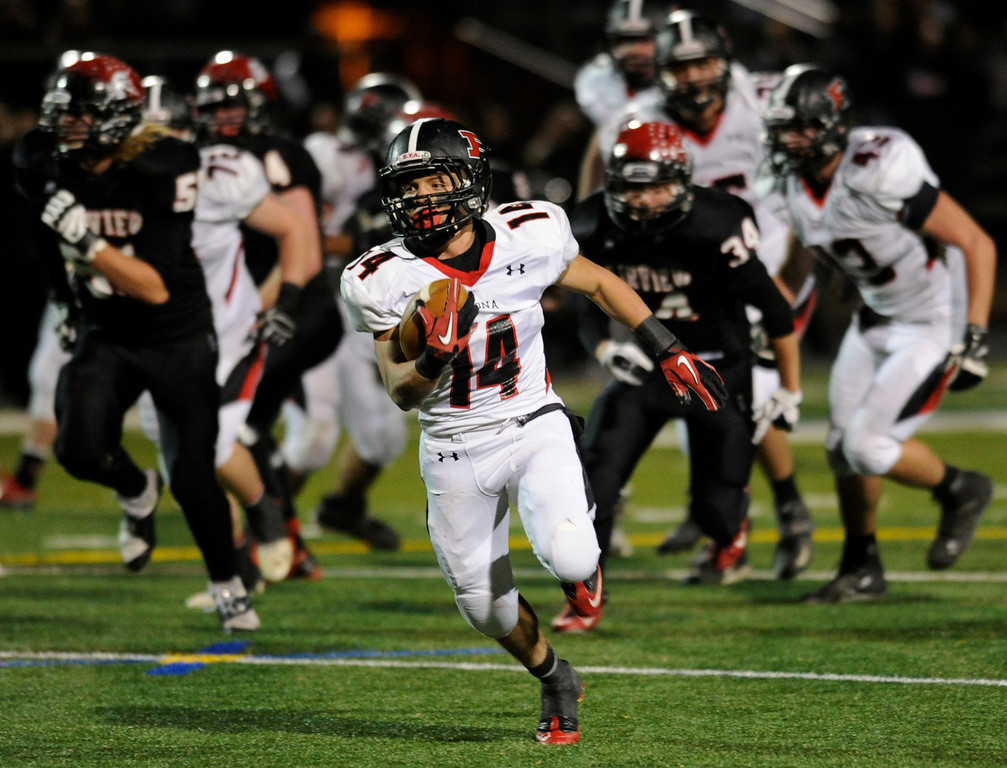 . BOULDER, CO. - NOVEMBER 15: Pomona running back Chris Marquez (14) broke free for a big gain in the second quarter. The Fairview High School football team hosted Pomona Friday night, November 15, 2003. Photo By Karl Gehring/The Denver Post