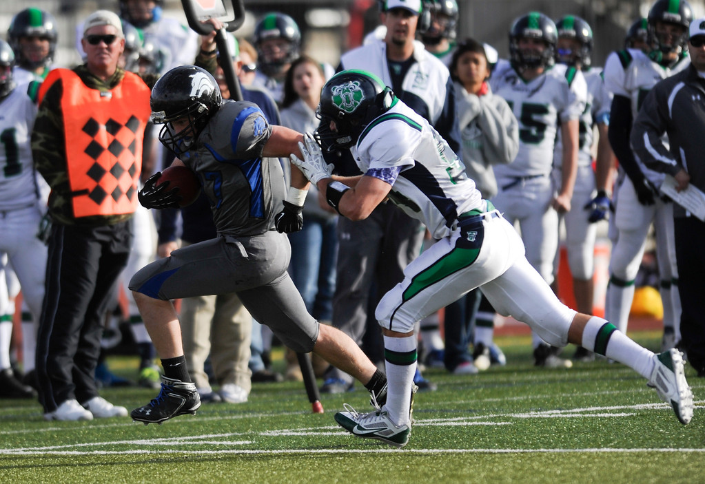 . AURORA CO: Nov. 16, 2013  Grandview\'s Jason Burger is shoved out of bounds during the game against ThunderRidge on Saturday, Nov. 16, 2013 at Legacy Stadium in Aurora, CO. ThunderRidge won 13 - 9.   (Photo By Erin Hull/The Denver Post)