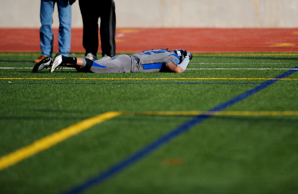 . AURORA CO: Nov. 16, 2013  Brandon Brooks of Grandview falls to the ground in the end zone after missing the 4th down to win take the lead at the end of the game. ThunderRidge won 13 - 9.  (Photo By Erin Hull/The Denver Post)