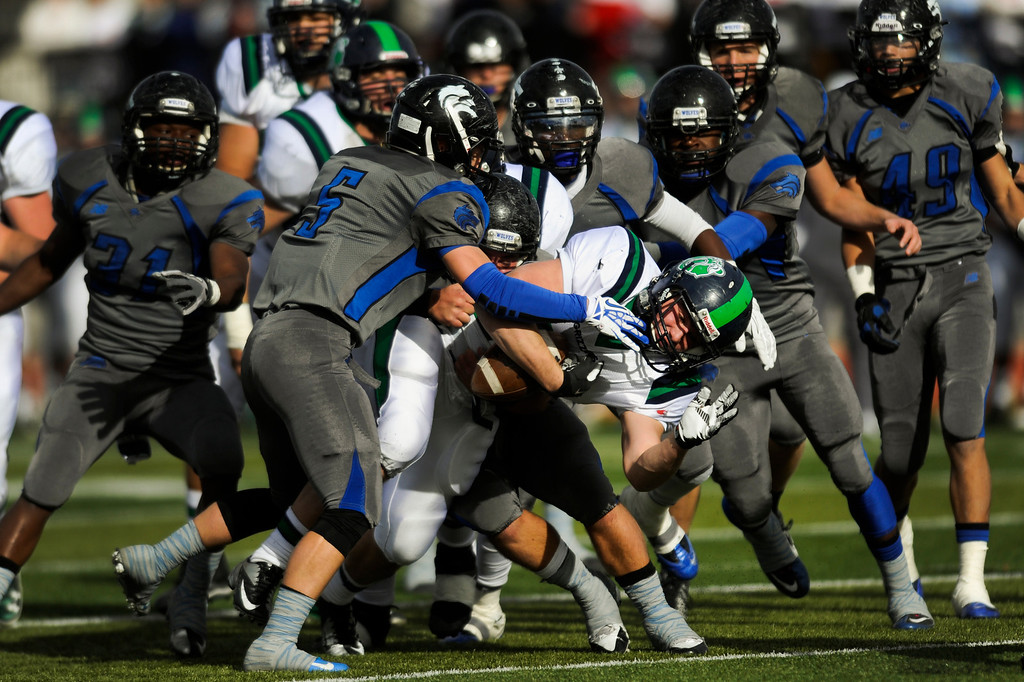 . AURORA CO: Nov. 16, 2013  Sam Cleland of Thunder Ridge is tackled by Grandview defense during their game on Saturday, Nov. 16, 2013 at Legacy Stadium in Aurora, CO. Thunder Ridge won 13 - 9.   (Photo By Erin Hull/The Denver Post)