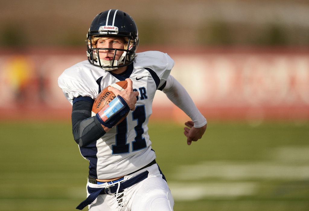 . AURORA CO. NOVEMBER 23 : A.J. Cecil of Valor Christian High School rushes for the touchdown in the 1st half of the 5A football semifinal game against Cherokee Trail High School at Legacy Stadium in Aurora, Colorado November 23, 2013. Valor Christian won 42-23. (Photo by Hyoung Chang/The Denver Post)