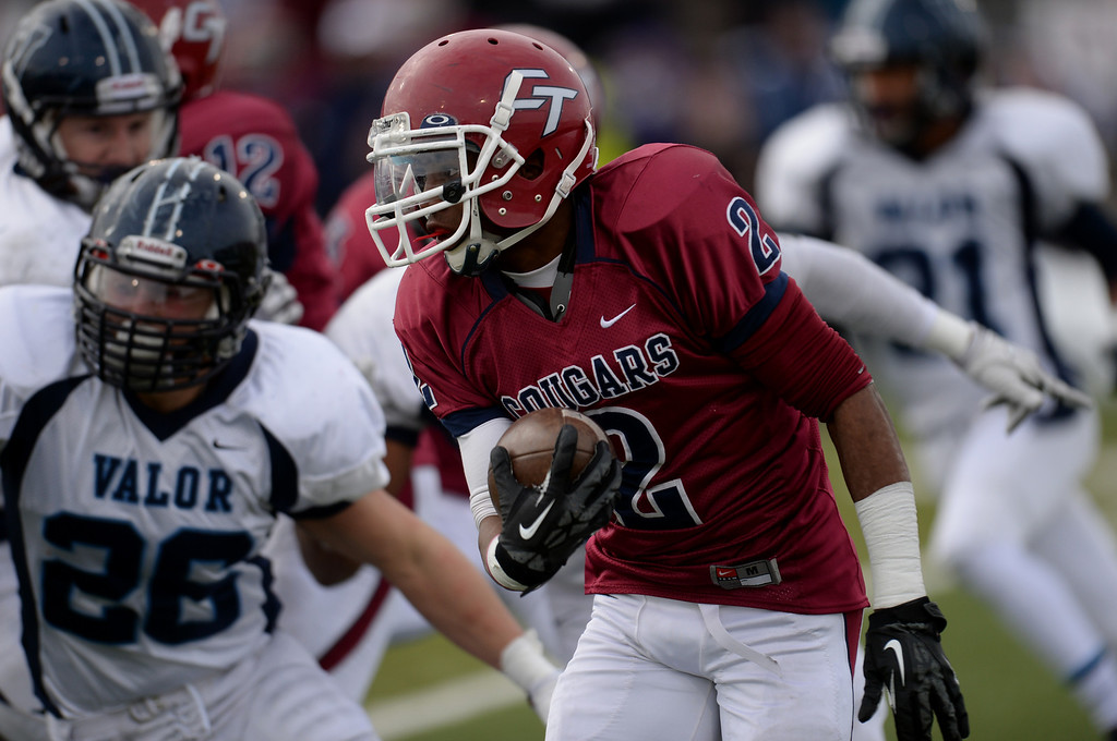 . AURORA CO. NOVEMBER 23 : Jason Thompson of Cherokee Trail High School (2) carries the ball during the 5A football semifinal game against Valor Christian at Legacy Stadium in Aurora, Colorado November 23, 2013. Valor Christian won 42-23. (Photo by Hyoung Chang/The Denver Post)