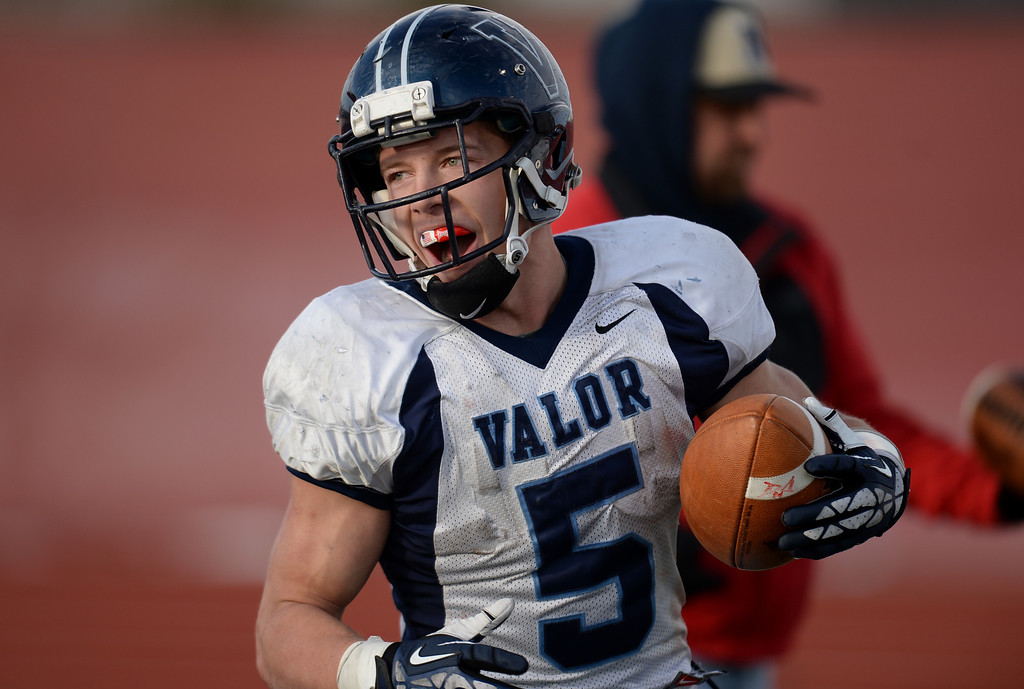 . AURORA CO. NOVEMBER 23 : Christian McCaffrey of Valor Christian High School celebrates a touchdown return after an interception during the 4th quarter the 5A football semifinal game against Cherokee Trail High School at Legacy Stadium in Aurora, Colorado November 23, 2013. Valor Christian won 42-23. (Photo by Hyoung Chang/The Denver Post)
