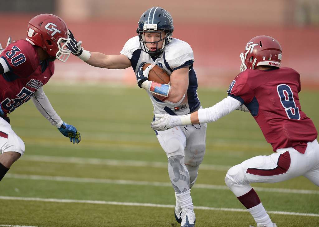 . AURORA CO. NOVEMBER 23 : Christian McCaffrey of Valor Christian High School (5) rushes between Mar\'keith Bailey (30) and Connor Stevens (9) of Cherokee Trail High School during the 5A football semifinal game at Legacy Stadium in Aurora, Colorado November 23, 2013. Valor Christian won 42-23. (Photo by Hyoung Chang/The Denver Post)